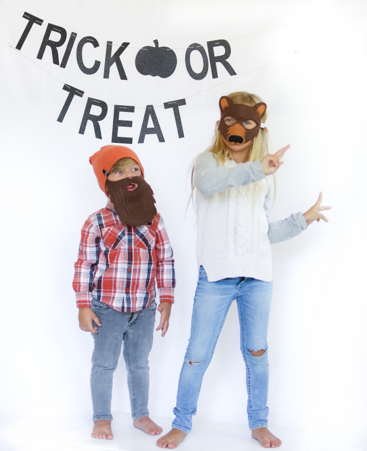 Glam Fete Trick or Treat black glitter word banner for Halloween and Fall Party